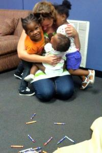 Earth angel, Amber Hood, getting hugs from children she works with