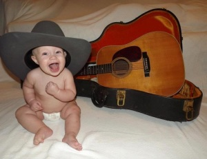 George's namesake, Georgia Leigh, with Grandpa's guitar and hat