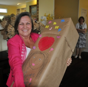 My mom with my baby shower gift, October 2012