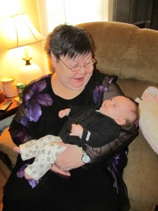 My neighbor's mom holding my daughter, January 2013